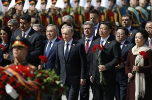 From left: Venezuela's President's wife Cilia Flores, Venezuela's President Nicolas Maduro, Kazakhstan's President Nursultan Nazarbayev, Russian President Vladimir Putin, unidentified man, China's President Xi Jinping, Mongolia's President Tsakhiagiin Elbegdorj, Chinese first lady Peng Liyuan, United Nations Secretary General Ban Ki-moon and other officials take part in a wreath laying ceremony on the Victory Day by the Kremlin walls in central Moscow, Russia, May 9, 2015. Russia marks the 70th anniversary of the end of World War Two in Europe on Saturday with a military parade, showcasing new military hardware at a time when relations with the West have hit lows not seen since the Cold War. (Maxim Shemetov, Pool photo via AP)